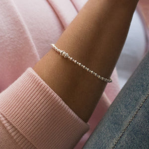 Delicate 925 sterling silver ball stacking bracelet with Dazzling multicut bead