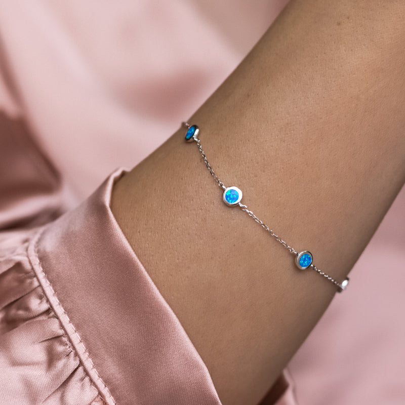 Elegant 925 sterling silver bracelet decorated with Sky blue Opal stones - Rhodium plated