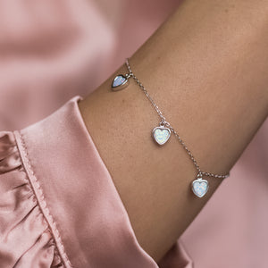 Adorable 925 sterling silver bracelet with white Opal heart charms