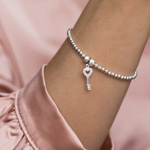 Adorable 925 sterling silver stretch bracelet with tiny key charm
