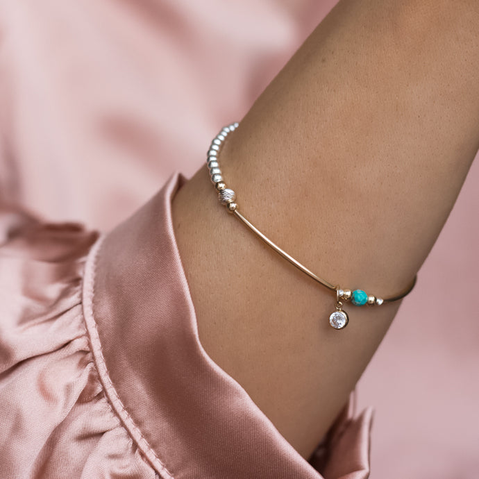 Delicate sterling silver stacking bracelet with 14k gold filled beads, Turquoise gemstone and Cubic Zirconia charm