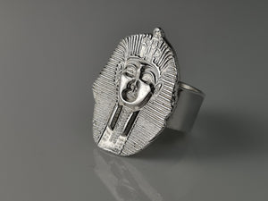 A fine handmade silver Egyptian Pharaoh set onto a wide sterling silver band. A part of the pieces of history collection, this piece is so unique.