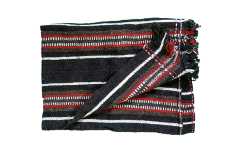 Black, white and red folded natural Yak hair blanket on white background