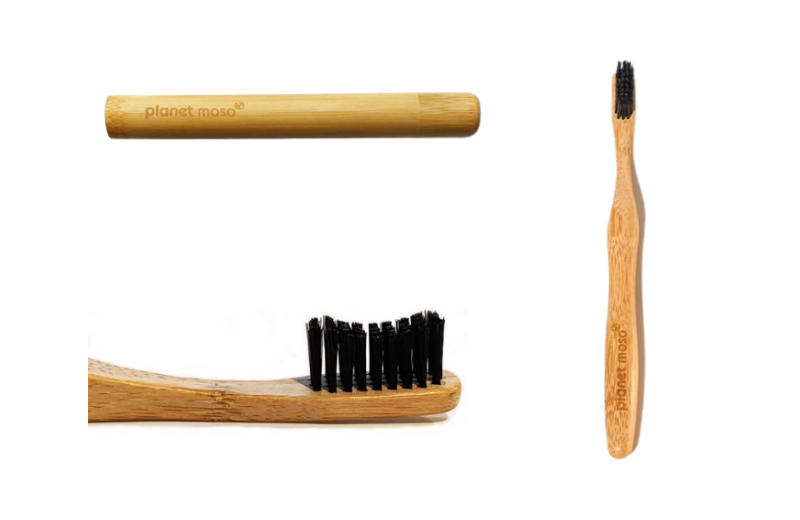 Natural bamboo toothbrush case, below bamboo toothbrush head and to side full length bamboo toothbrush on white background