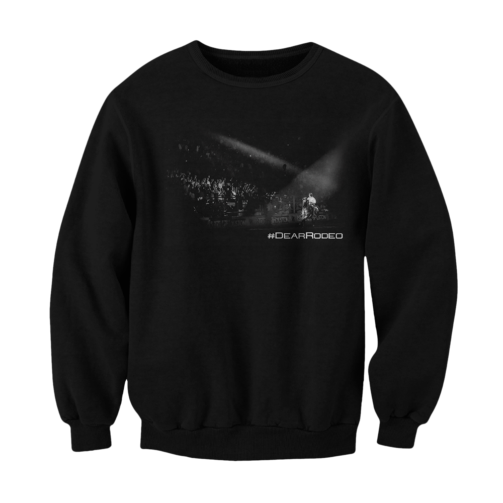 Black pullover sweater. Print is black and white picture of Cody onstage playing in front of fans. Underneath the right side of the photo says