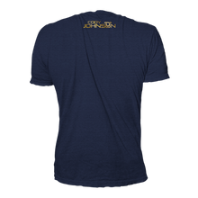 Load image into Gallery viewer, Back of Navy blue shirt, Cody Johsnon name and logo is at the top in small font, with the same gold lettering.