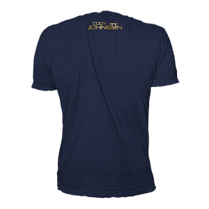 Back of Navy blue shirt, Cody Johsnon name and logo is at the top in small font, with the same gold lettering.