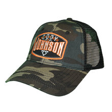 "Load image into Gallery viewer, Cody Johnson Camo with Orange Patch Hat with mesh back side. The patch in front says ""Cody Johnson"" in white with orange accents, and a small white bull horns logo below."