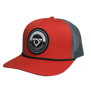 Red Staunch Collection Hat. The front side of the hat is red, with a black and white circle patch bull horns logo. the back side is grey mesh.