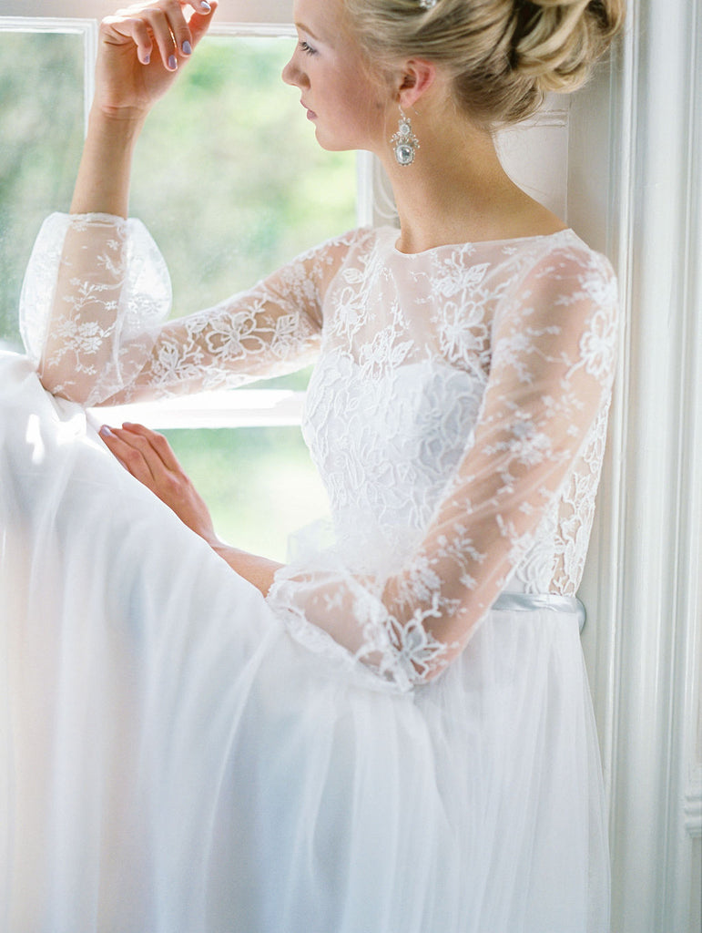 Romantic tulle wedding dress with boat neckline and long lace sleeves. Custom designed by Catherine Langlois, Toronto, Ontario, Canada.