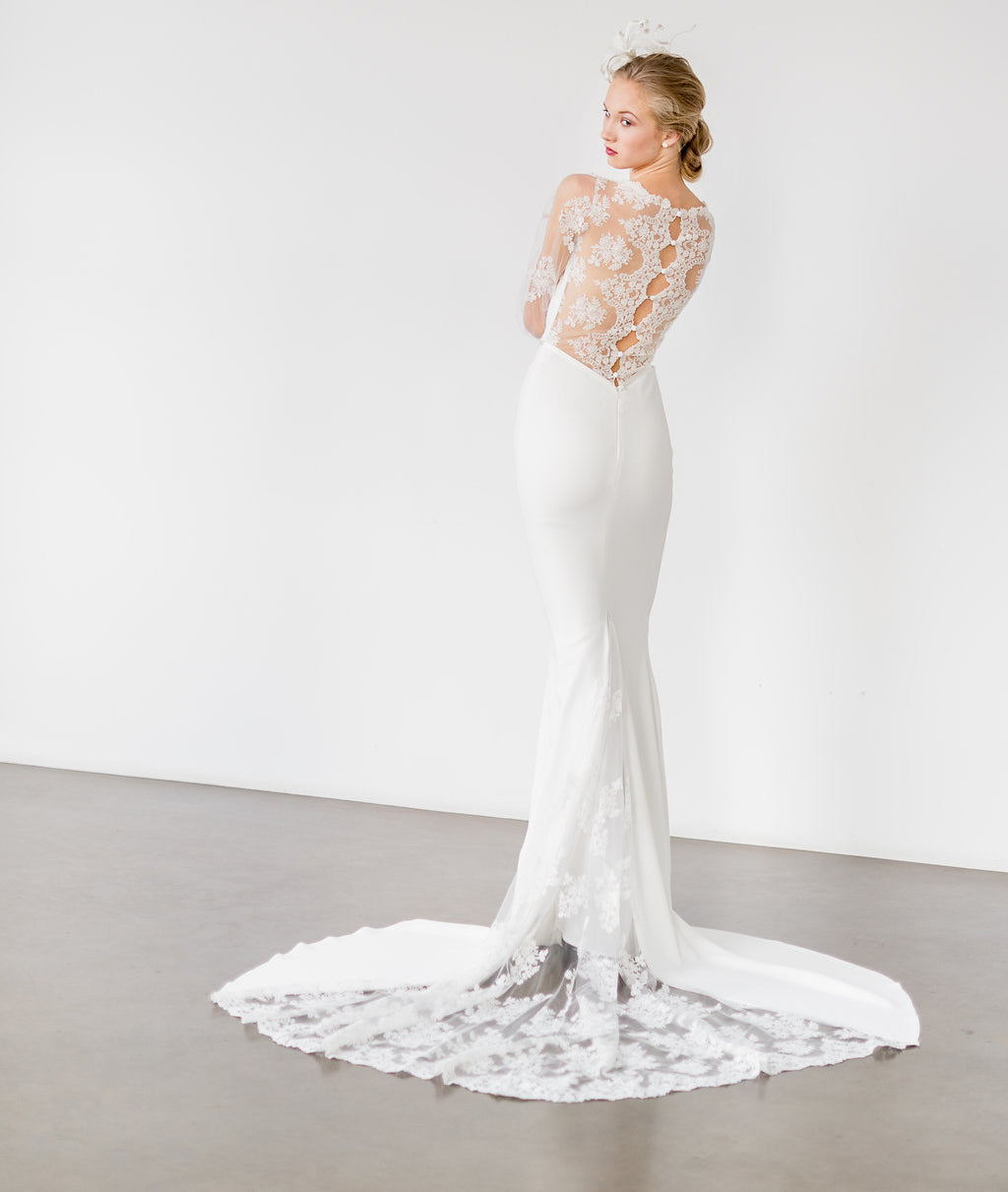 Modern and romantic backless lace wedding dress by Catherine Langlois. Custom made to order in Toronto, Ontario, Canada. Photo by Whitney Heard.