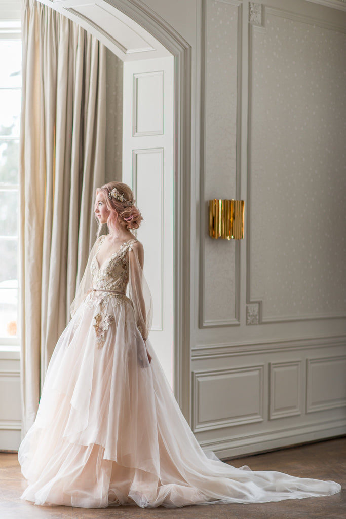 Whimsical and romantic, the airy Jasmine wedding dress designed by Catherine Langlois. Made in Toronto, Ontario, Canada.
