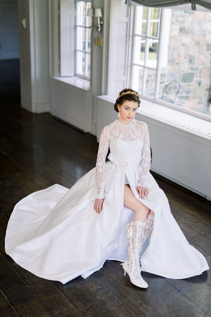 Modern yet classic two piece wedding dress with a full skirt and lace mini dress. Designed by Catherine Langlois in Toronto, Ontario, Canada.