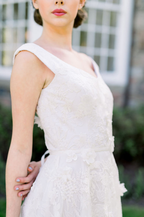Romantic lace wedding dress with off the shoulder neckline. Designed by Catherine Langlois in Toronto, Ontario, Canada.