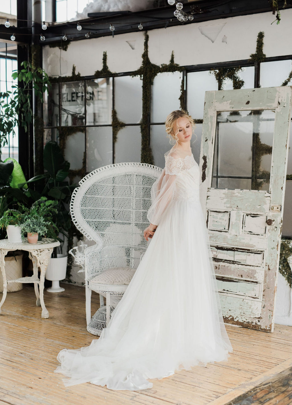 Delicate  lace and tulle wedding dress with long sleeves by Catherine Langlois. Made to order in Toronto, Ontario, Canada. Photo by Destiny Dawn.