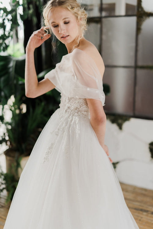 A modern princess wedding dress with yards of beaded and appliqued tulle. Designed and hand made by Catherine Langlois in Toronto, Ontario.