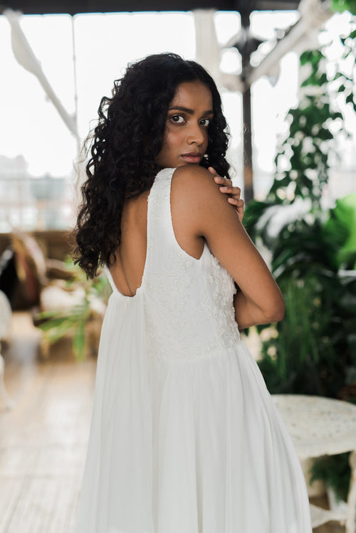 Floaty chiffon and silk wedding dress with a beaded top by Catherine Langlois. Made to order in Toronto, Ontario, Canada. Photo by Whitney Heard.
