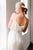 Perfect wedding dress for a city or micro wedding! Sensous silk wraps the body with a mock wrap and a modern slit. Custom made by Catherine langlois in Toronto, Ontario, Canada.