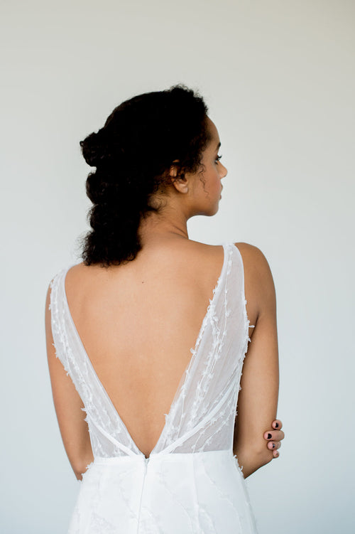 Embroidered tulle fit and flare wedding dress with a low v back. Designed by Catherine Langlois in Toronto, Ontario, Canada.