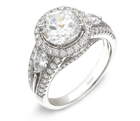 A Superb Pave Diamond Halo Engagement Ring with Pear Shape Side Diamonds by Simon G.