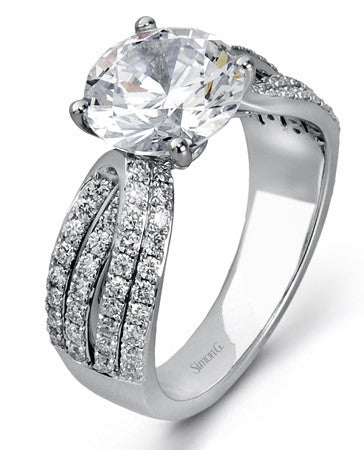 Impressive Overlapping Design Engagement Ring with Pave Set Diamonds by Simon G.