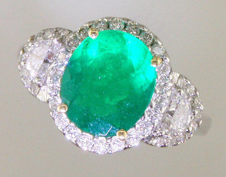Fabulous Custom Design Ring Featuring an Oval Emerald and Half Moon Diamond Sides by Teels Jewelry