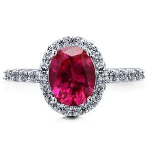 Lovely 18k White Gold Oval Ruby and Diamonds Halo Ring by Teels Jewelry