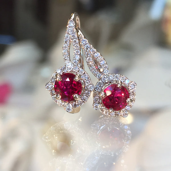 Vibrant Ruby and Diamond Halo Earrings by Teel's Jewelry