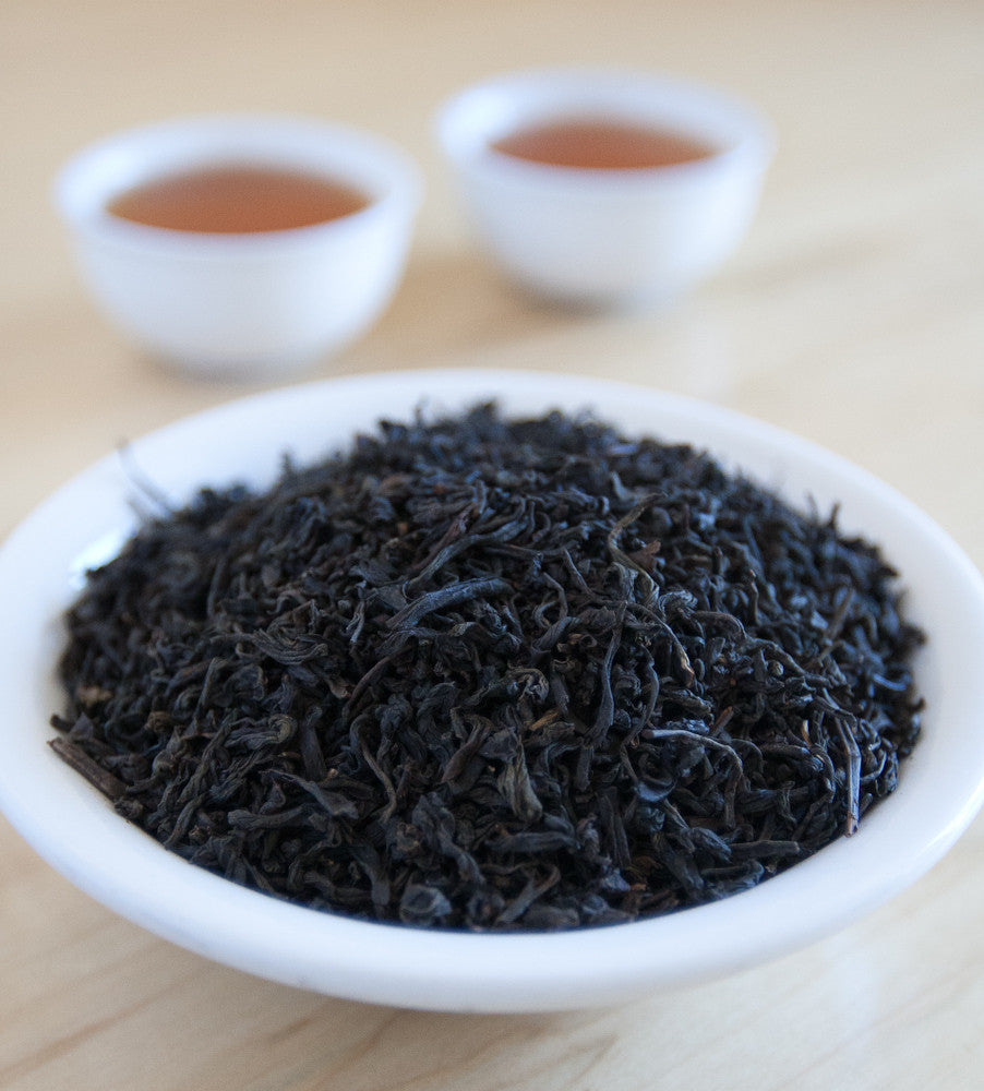 Lapsang Souchong, Chinese black tea, features hand picked leaves that are smoked over pine wood fires to create this distinctive, very smoky tea.
