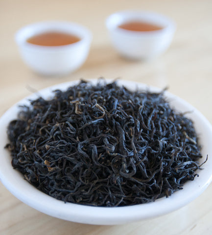 Red Dragon Keemun, Chinese black tea, brews into a lovely reddish cup with bold, yet smooth flavors with a hint of chocolate and smoke on the finish.