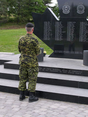 Soldier standing in front of the Afghanistan memorial at Canadian Forces Base Petawawa, Ontario, Canada