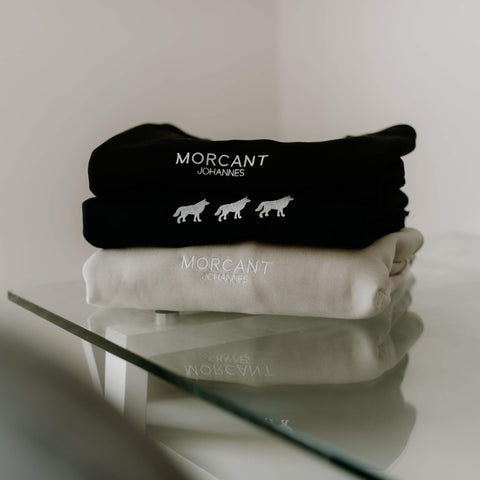 Morcant comfortable and versitile essentials, artistically pictured on reflecting glass table