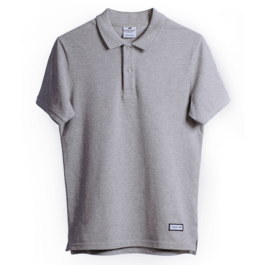 Full image of our grey organic Morcant polo shirt, in a tailored fit, featuring a Morcant designer patch at lower left hem.