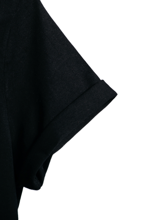 Detail image of our black organic Morcant hoodie, magnifying the finely rolled right sleeve.