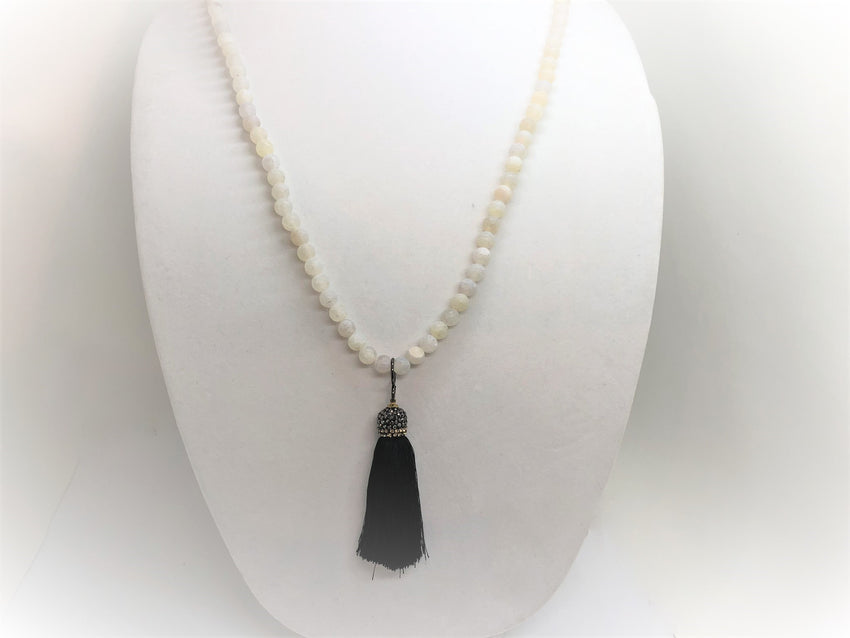 long matter white agate necklace with a black silk tassel