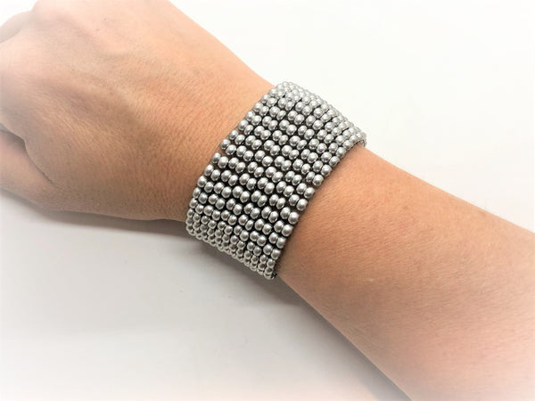 Looks like metal handsewn glass bead bracelet silver