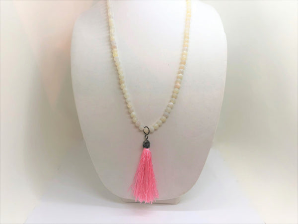 long matter white agate necklace with a pink silk tassel
