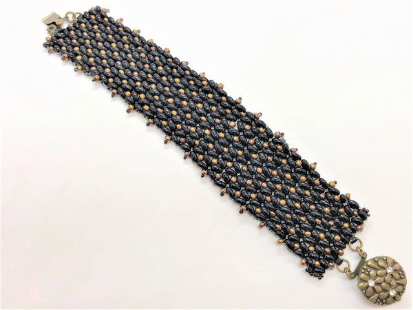 Black and Bronze X&O hand sewn bracelet