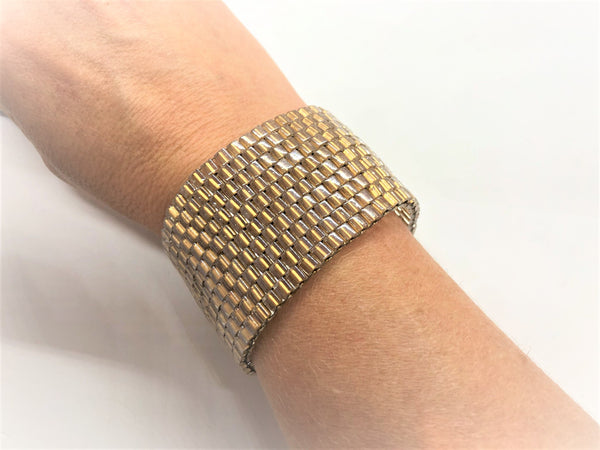 Glass Wall handsewn bracelet - gold on wrist