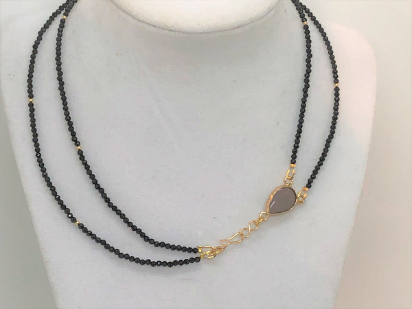 2 strands of Black onyx  2mm faceted beads surround a pear shaped grey agate bead with a hook and eye gold filled closure