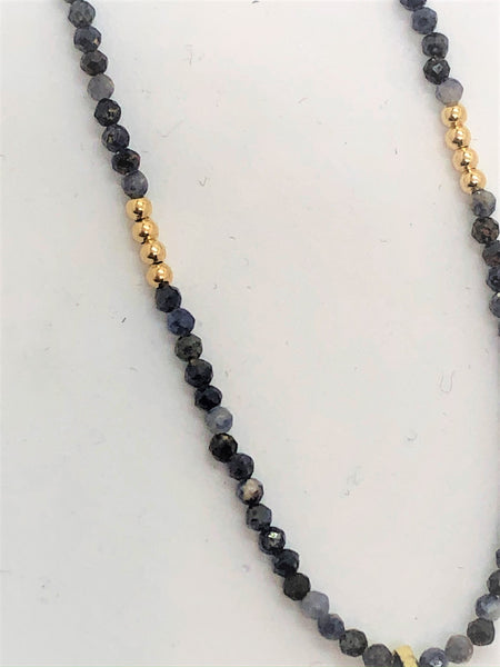 Mini Sodalite faceted beads with gold filled 2mm balls with a kyanite pendant close up