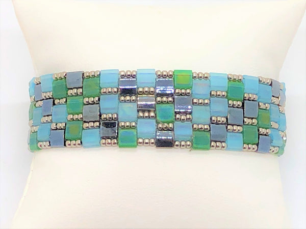 Pastel quilted handsewn bracelet with silver plated clasp and silver beads