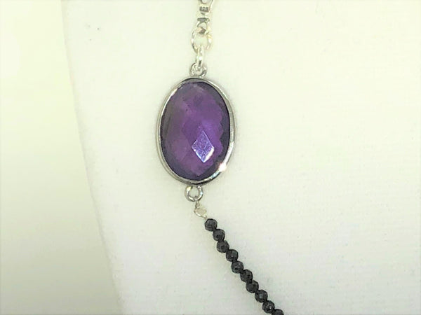 close up of faceted oval amethyst stone with silver plating