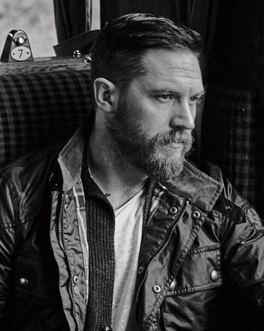 Tom Hardy beard wearing a Belstaff Jacket - On a Train - best groomed British men
