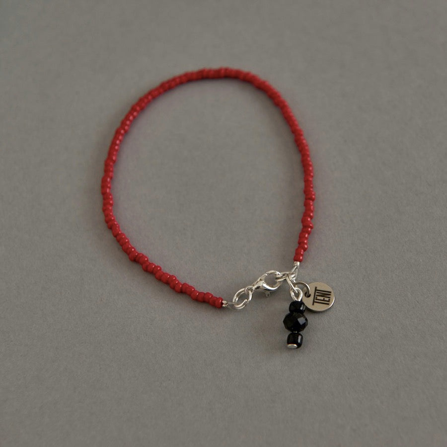 Tent Nutrition mens red and black beaded bracelet