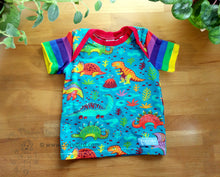 Load image into Gallery viewer, Dinosaur Rainbow baby top -Dorybird kids shirt -colorful dino -dinosaur baby shirt -rainbow stripes -teal toddler tee -1st birthday gift, handmade, made in USA