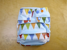 Load image into Gallery viewer, birthday party pennants cloth diaper, rainbow flags blue cloth diaper, medium sized WAHM diaper, Chickadee cloth, bamboo hemp, made in USA
