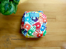Load image into Gallery viewer, Rainbow Handprints Cloth Diaper -Chickadee Small (10-17 lbs.) AIO -paint handprint art -finger painting -WAHM all in one -hemp bamboo -baby shower gift -made in USA
