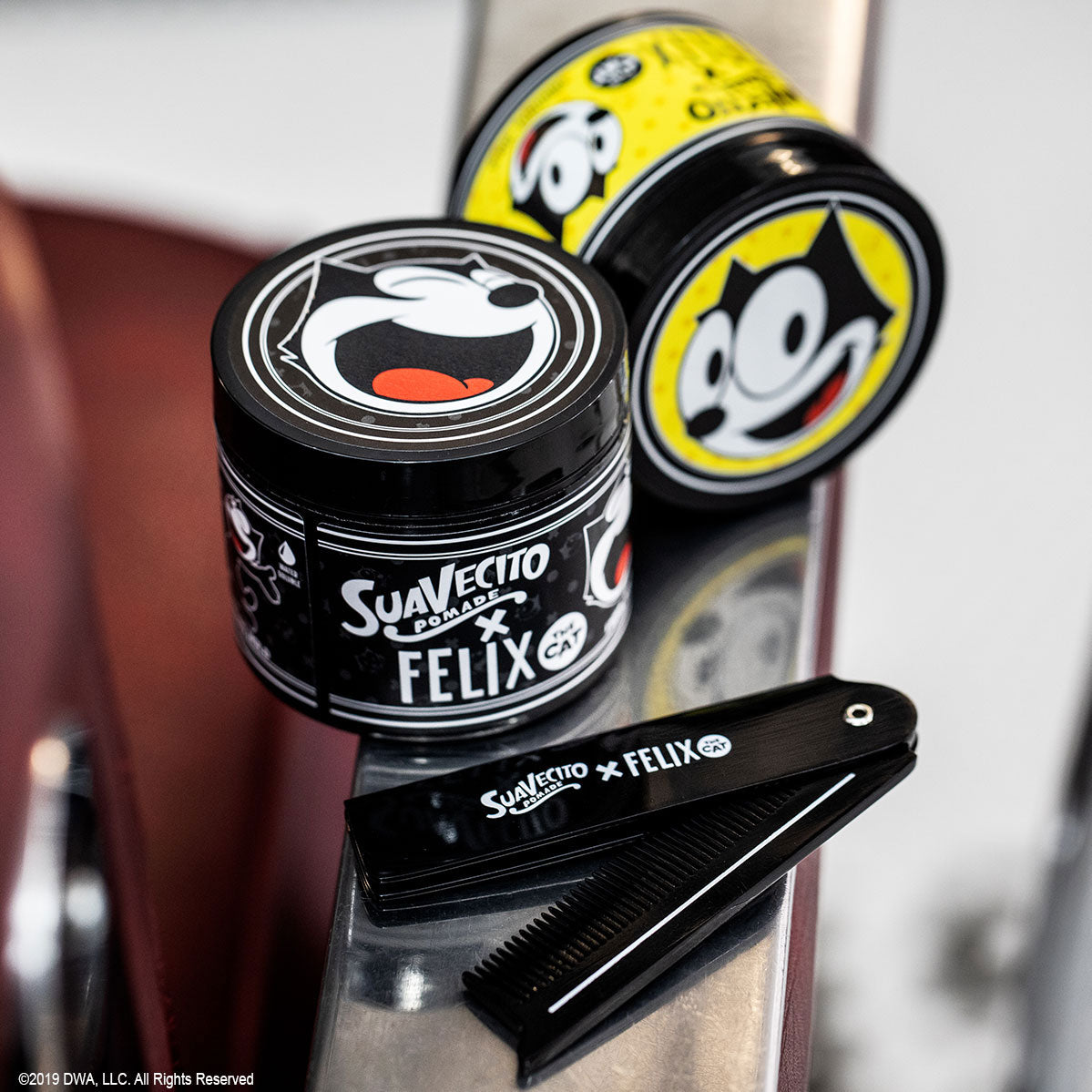 Suavecito X Felix the Cat Pomade on a barber chair