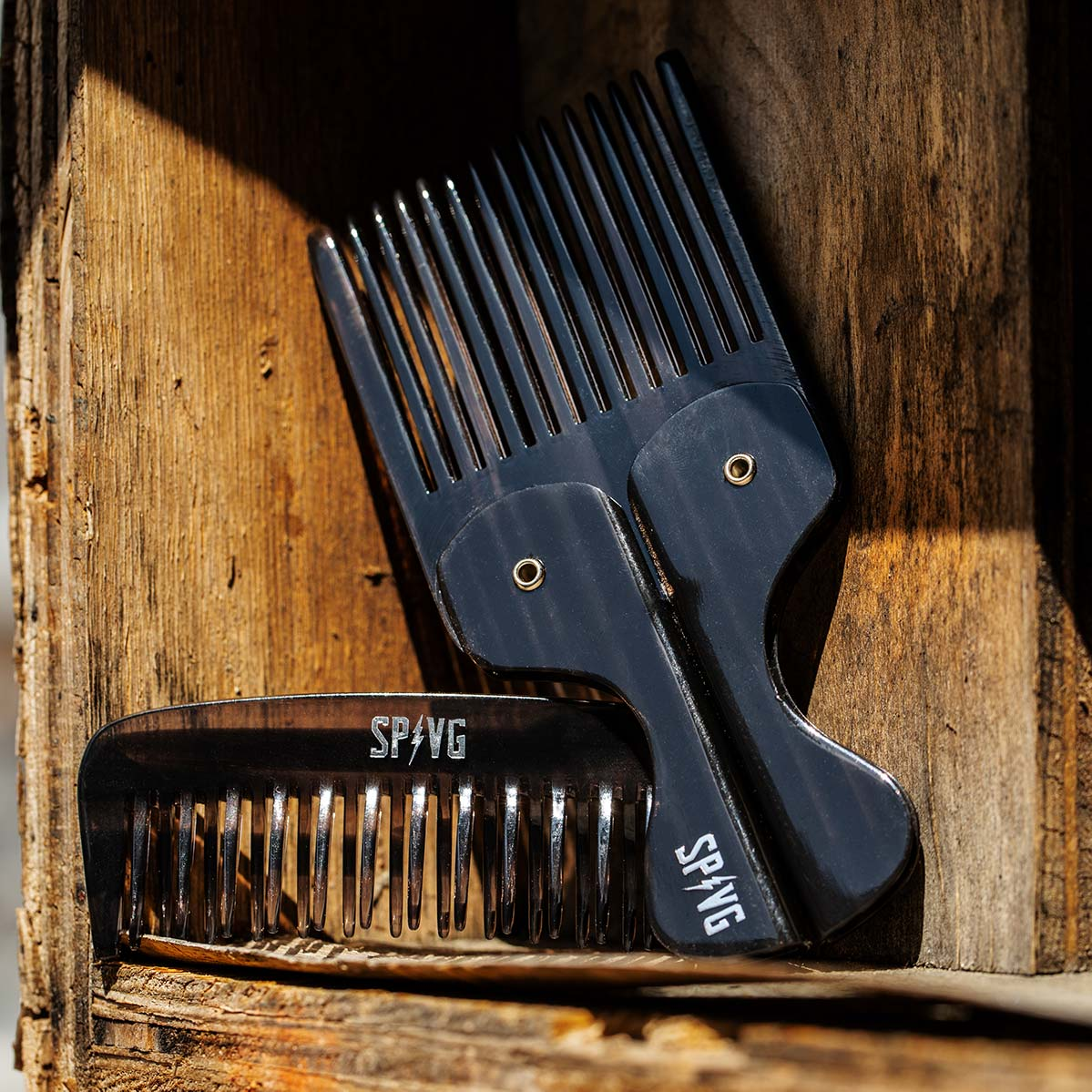 9f5900ee774 Suavecito x Violent Gentlemen limited edition beard combs leaning on wood